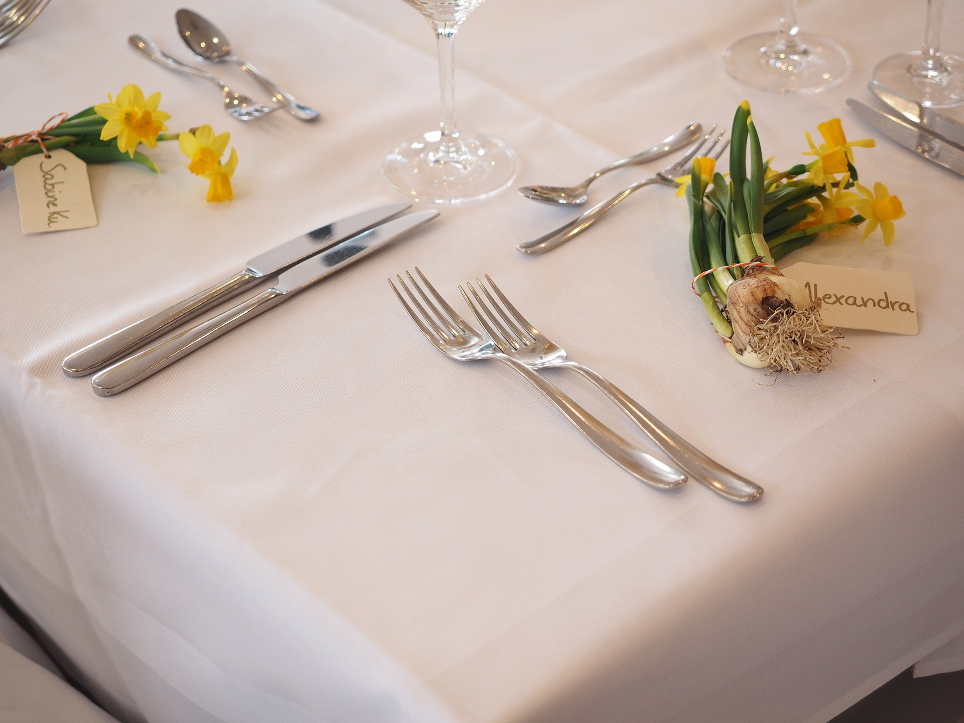 Fresh flowers make surprising and quirky place settings.