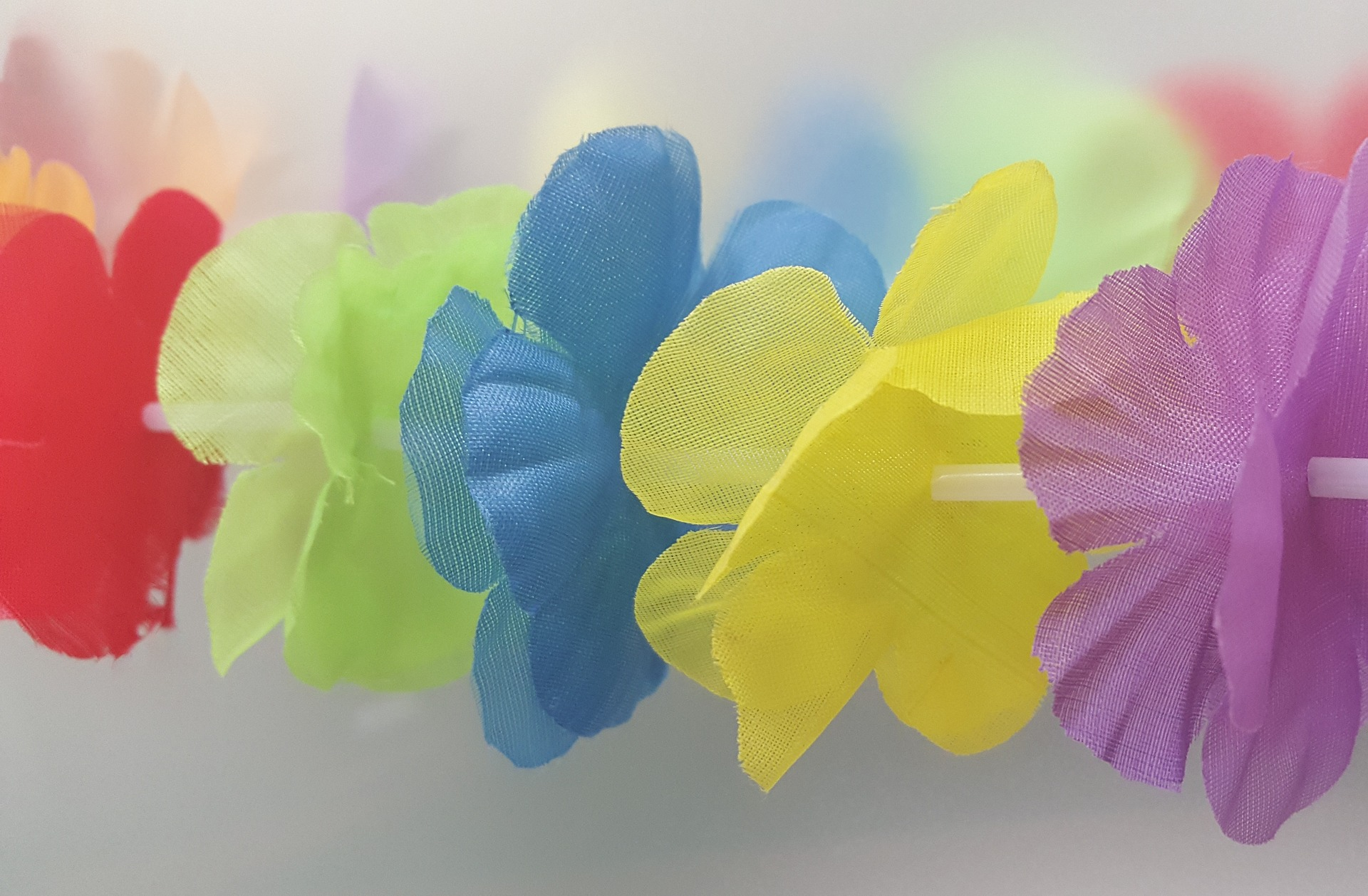 Hawaiian Leis are easy to make and are the perfect accessories for a tropical luau.